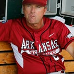 In this June 22, 2012, file photo, Arkansas head coach Dave Van Horn (2) sits in the dugout prior to a game against South Carolina at the 2012 College World Series at TD Ameritrade Park in Omaha, Neb.
