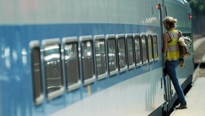 A passenger boards the Grand Central-bound Metro North Railroad train from Poughkeepsie.