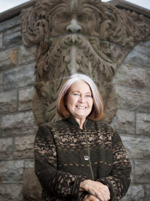 Fri., Jan. 13, 2017: Long-time community activist and leader Patricia Garry stands in front of the Green Man sculpture Ð the centerpiece of Green Man Park in Walnut Hills. The sculpture was salvaged from a building that was to demolished decades ago. Last month, Garry retired from a long stint at the Community Development Corporation Association of Greater Cincinnati, the founder of a web of organizations that grow neighborhoods. The organization was crucial in making sure the park was set aside as public green space.