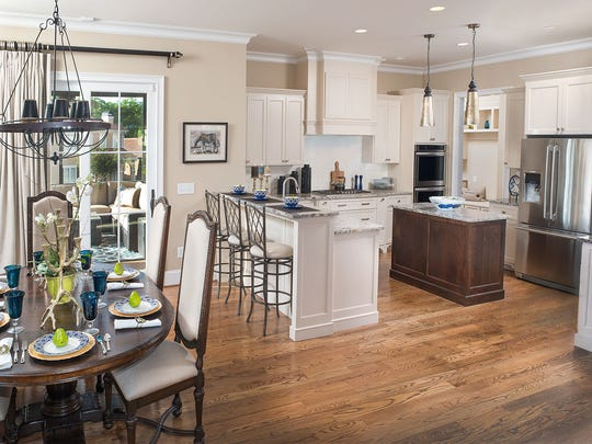 J. Francis Builders captures all three important concepts in the custom kitchen: a sizeable island, open entertaining space, and bar-top seating area.  Flanked by a traditional eating area to the side, the kitchen serves as the true heart of the home.