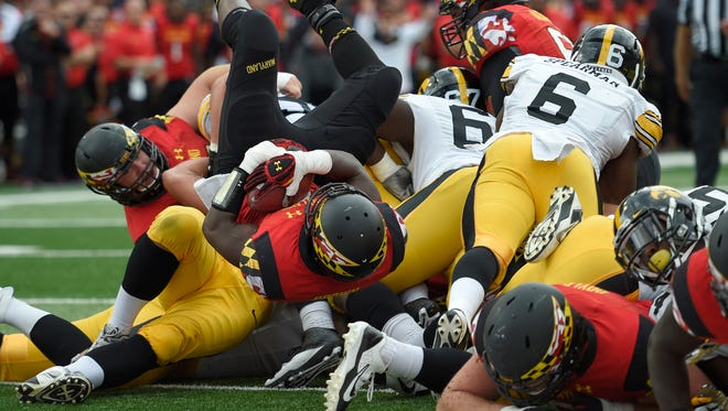 Maryland running back Wes Brown, center, tumbles into the end zone in a 38-31 win over Iowa on Saturday.