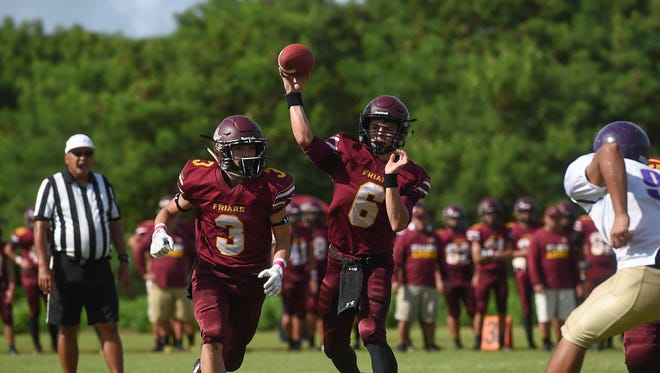 Father Duenas quarterback Daniel Phillips (6) makes a pass against the George Washington Geckos during their Interscholastic Football League game at the University of Guam Field on Oct. 7, 2017.
