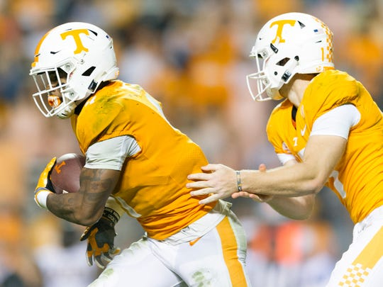 Tennessee running back John Kelly (4) is handed the ball by Tennessee quarterback Will McBride (17) during an game between Tennessee and Southern Miss at Neyland Stadium in Knoxville, Tennessee, on Saturday, Nov. 4, 2017.
