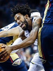 Memphis Grizzlies guard Mike Conley is fouled by the