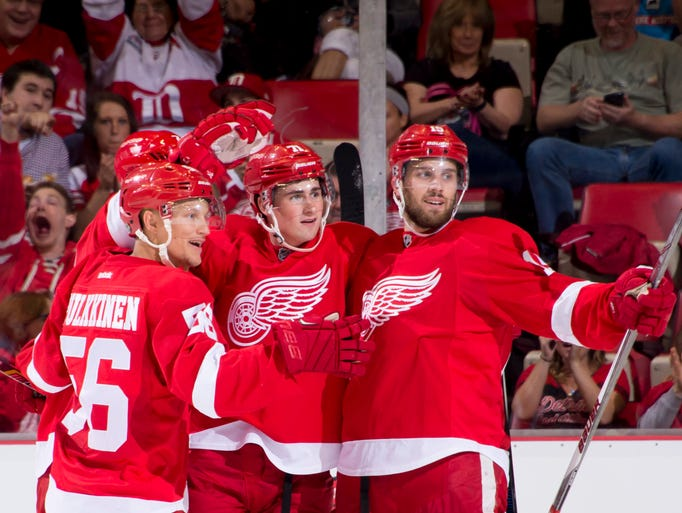 From left, Detroit Red Wings Teemu Pulkkinen, Dylan