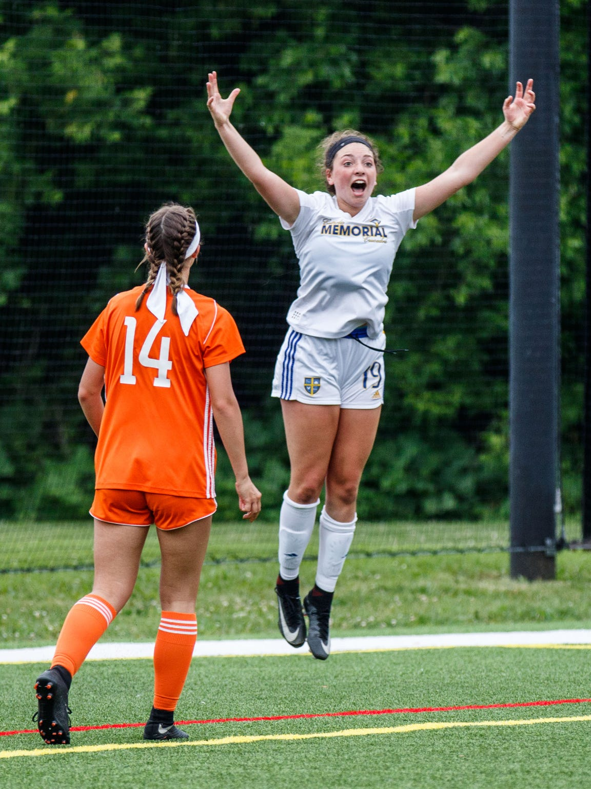 Catholic Memorial junior Shannon McWilliams (19) celebrates