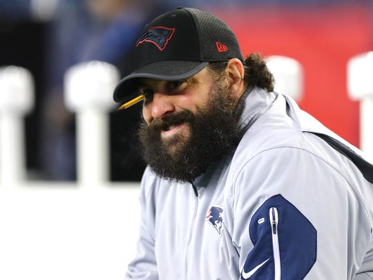Patriots defensive coodinator Matt Patricia sits before