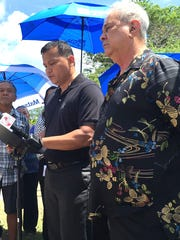 In this May file photo, Roy Taitague Quintanilla, center,