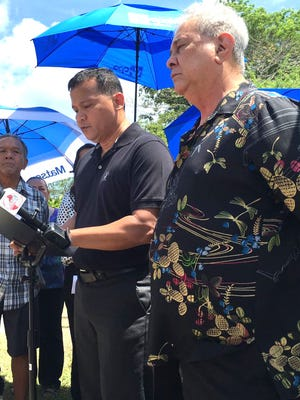In this May file photo, Roy Taitague Quintanilla, center, in black shirt, speaks at a press conference, alleging that Archbishop Anthony Apuron molested him 40 years ago. Attorney David Lujan, right, and others stand around him outside the Archdiocese of Agana in Hagåtna.