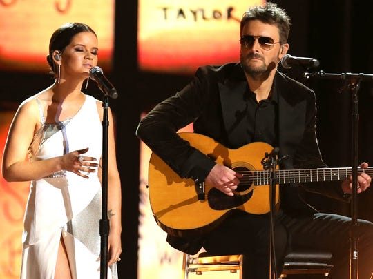 """Maren Morris, left, and Eric Church perform """"Tears in Heaven"""" as a tribute to the Las Vegas shooting victims Jan. 28, 2018, at the 60th annual Grammy Awards at Madison Square Garden in New York."""