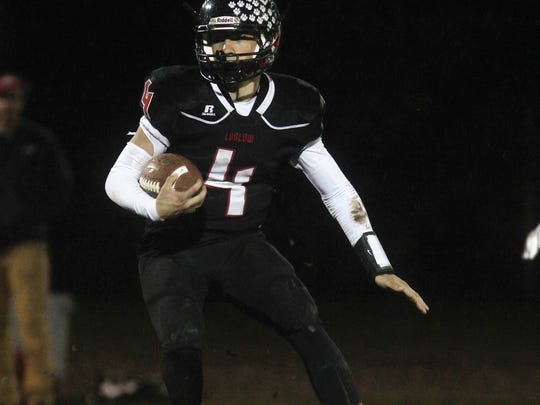 Ludlow junior QB Ian Vallandingham looks for running