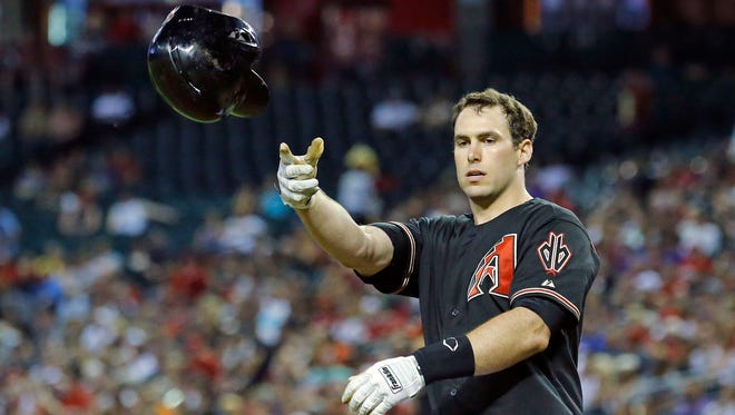 Diamondbacks first baseman Paul Goldschmidt throws his helmet after striking out against the Reds to end the third inning on Saturday, May 31, 2014, in Phoenix.