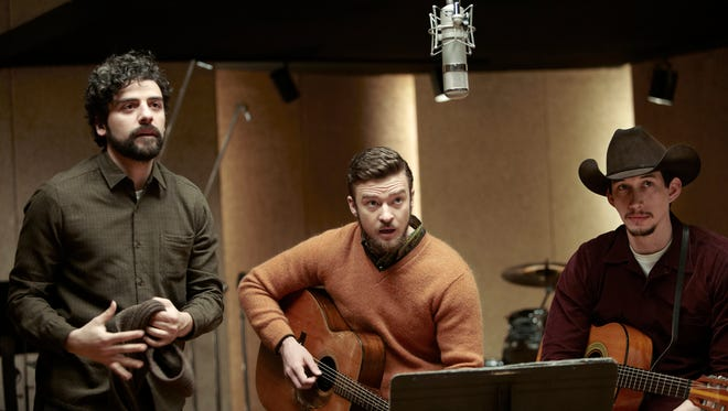 Oscar Isaac, left, and Justin Timberlake in a recording-session scene from 'Inside Llewyn Davis.'