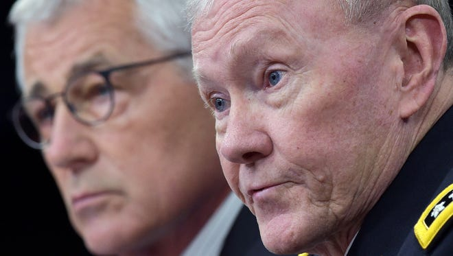 Defense Secretary Chuck Hagel and Chairman of the Joint Chiefs of Staff Martin Dempsey take part in a news conference at the Pentagon on Sept. 26, 2014.