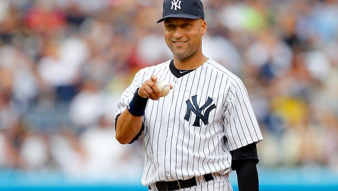 FILE - NOVEMBER 1: According to reports November 1, 2013, the New York Yankees have signed Derek Jeter has signed a one-year deal for $12 million. NEW YORK, NY - JULY 28:  Derek Jeter #2 of the New York Yankees in action against the Tampa Bay Rays at Yankee Stadium on July 28, 2013  in the Bronx borough of New York City. The Yankees defeated the Rays 6-5.  (Photo by Jim McIsaac/Getty Images) ORG XMIT: 163494755 ORIG FILE ID: 175353984