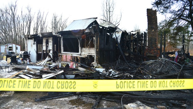 The scene of a deadly fire in Muhlenberg Co. where nine members of the Watson family were killed and two were seriously injured on Thursday, Jan. 30, 2014.