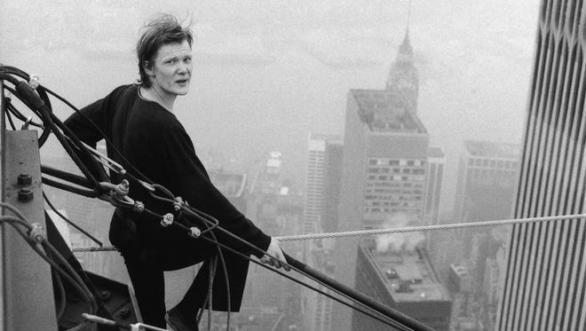 French tightrope walker Philippe Petit, 24, looks back at a photographer as he rests between walks on a cable stretched between New York's World Trade Center towers.