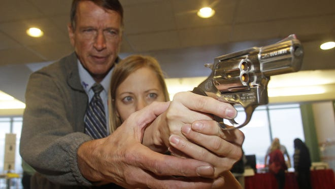 Cori Sorensen, a fourth-grade teacher from Highland Elementary School in Highland, Utah, receives firearms training with a .357 magnum from personal defense instructor Jim McCarthy during concealed weapons training Dec. 27, 2012, for 200 Utah teachers in West Valley City, Utah.