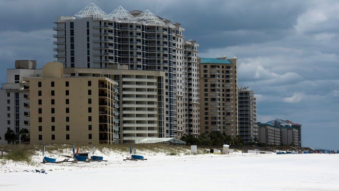Visitors to Perdido Key are being asked to remove personal items from the beach at night to accommodate protected wildlife in accordance with the county's habitat protection plan. Development on Perdido Key is pictured on Friday, May 5, 2017.
