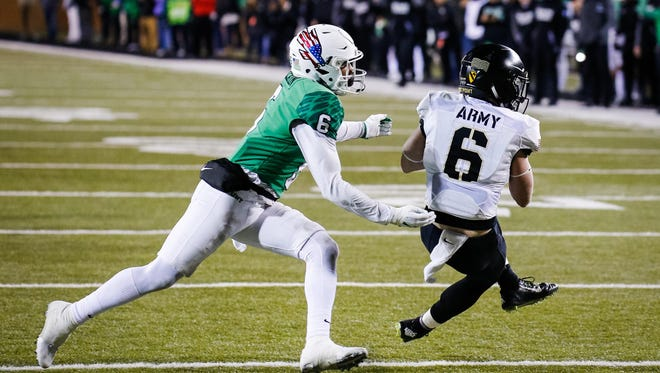 Nov 18, 2017; Denton, TX, USA; Army running back John Trainor (6) is tackled by North Texas Mean Green safety Kishawn McClain (6) after making the only reception of the game for the Black Knights during the second half at Apogee Stadium. Mandatory Credit: Ray Carlin-USA TODAY Sports