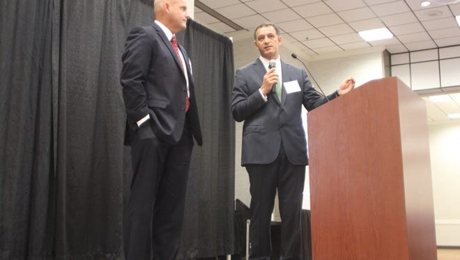 Deputy Chief Eric McBride of the San Bernardino Police Department, left, and Dr. Michael Neeki, who was a first responder after the San Bernardino terror attack, discuss about the evolution of terror attack response and victim care during a workshop at the Tucker Civic Center Thursday.