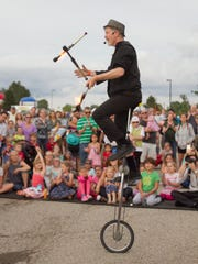 John Park performs his comedy juggling act Friday, June 23, 2017 in front of the main stage at Michigan Challenge Balloonfest. Retiring Howell Area Chamber of Commerce President Pat Convery was hired to grow the event in 1990.