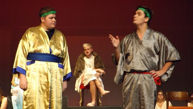 """Aeschylus (Jon Pilat), Dionysus (Nathan Edwards) and Euripides (Wesley Bessaw) argue the finer points of Greek drama in """"The Frogs."""""""