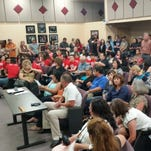 Audience members pay attention as the Las Cruces Public School school board prepares to meet Tuesday.