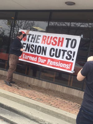 Retired truck drivers and other Teamsters voiced loud opposition to proposed pension cuts at town hall meetings, such as one in Detroit in February.