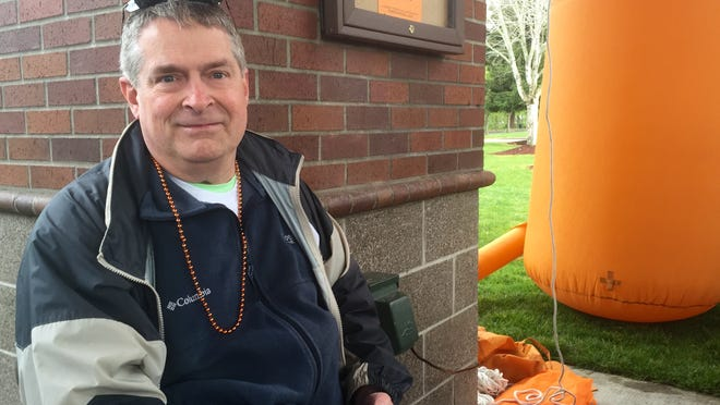 Dale Turner rests up before walking to the Capitol Building Saturday, April 11, for Salem's multiple sclerosis walk.