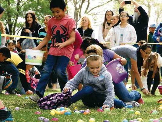 Children made mad dashes to fill their Easter Baskets during the sixth annual Community Easter Egg Hunt on Saturday at Luna County Courthouse Park.