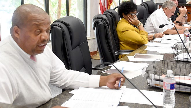 Parish council member Jerry Red Jr. asks a question during Wednesday night's St. Landry Parish Council Meeting.