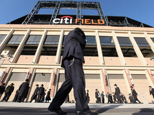 Ultra-Orthodox Jews gather before entering Citi Field to discuss the risks of using the Internet on May 20, 2012. More than 40,000 were expected to attend the rally at the home of the New York Mets.