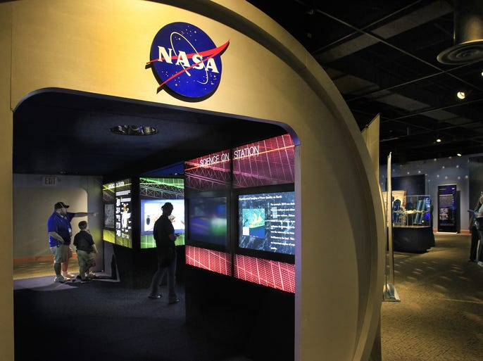 'Destination Station,' NASA's traveling exhibit on the International Space Station, is at the Indiana State Museum in Indianapolis through June 29. The exhibit, photographed on Tuesday, April 29, 2014, opened on Saturday and features multimedia displays showing the impact the science being conducted on the space station is having on everyday lives. The exhibit, hosted by the State Museum, is designed for visitors of elementary-age and older.
