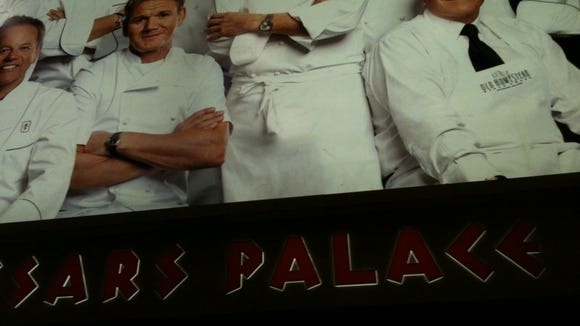 This poster of celebrity chefs greats you in the Las Vegas airport.