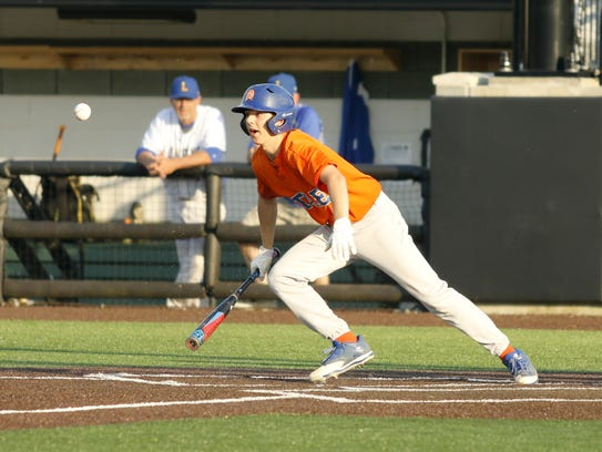 Xander Burch bunts for a hit for Thomas A. Edison against