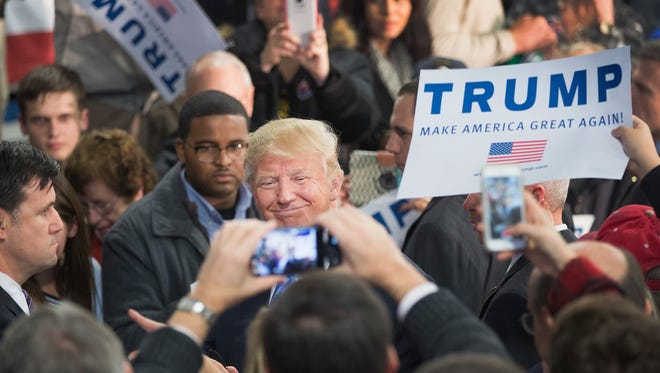 Republican presidential candidate Donald Trump greets guests at a campaign event in Davenport, Iowa, on Dec. 5, 2015.
