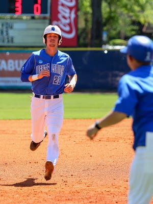 UWF's Matthew Jones (23) heads to third base after an errant pick-off throw to second base by West Georgia pitcher Andres Fernandez on Jim Spooner Field at the University of West Florida on Saturday, March 31, 2018.