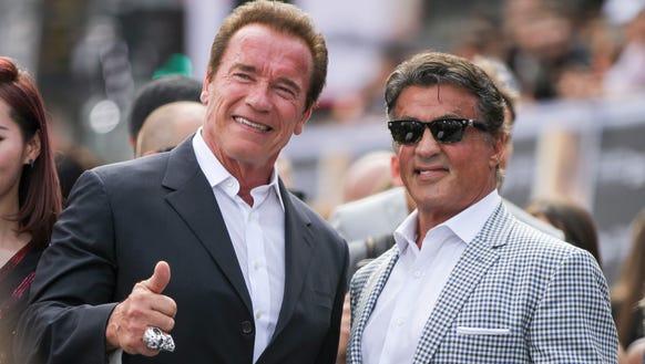 Arnold Schwarzenegger, left, and Sylvester Stallone