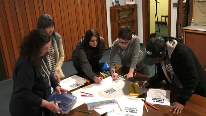 Organizers for the March for Our Lives met Thursday to create fliers for the event on March 24.