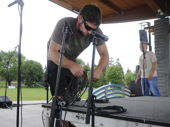 Sound tech for Wright Sound & Lighting Mike Borell sets up the stage before Summertime by George! on July 15 at Lake George.