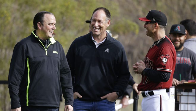Arizona Diamondbacks President & CEO Derrick Hall, Sr. Advisor to the President & CEO Luis Gonzalez and manager Torey Lovullo at spring training camp on Feb. 17, 2017 at Salt River Fields in Scottsdale, Ariz.