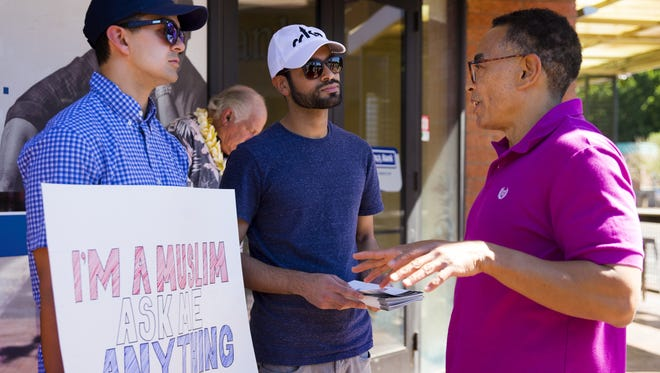 Soleman Haque (left) and Mabroor Khan (center) of Mesa talk to Mike Brown of Mesa during the inaugural National Meet a Muslim Day in Tempe on March 11, 2017.