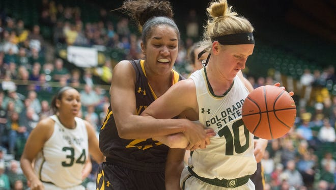CSU guard Hannah Tvrdy and Wyoming forward Bailee Cotton collide during a battle for possession of the ball during a game at Moby Arena on Saturday, January 13, 2018. The Rams couldn't keep up with Wyoming, losing 53-49.