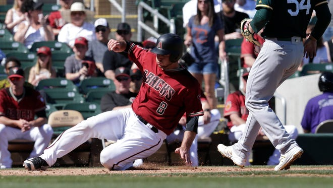 Mar 7, 2017: Arizona Diamondbacks catcher Chris Iannetta (8) scores on a passed ball in the second inning against the Oakland Athletics during a spring training game at Salt River Fields at Talking Stick.