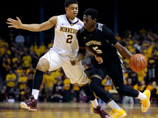 Minnesota guard Nate Mason (2) defends against Maryland-Baltimore County guard Jourdan Grant (5) during the first half of an NCAA college basketball game Saturday, Nov. 22, 2014, in Minneapolis. (AP Photo/Hannah Foslien)