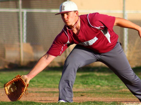 Tularosa's Darren Hood stretches out to snag a throw to first base during practice Thursday.