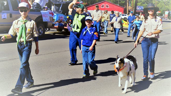 Boy scouts participated in the Aspenfest Parade in Ruidoso.