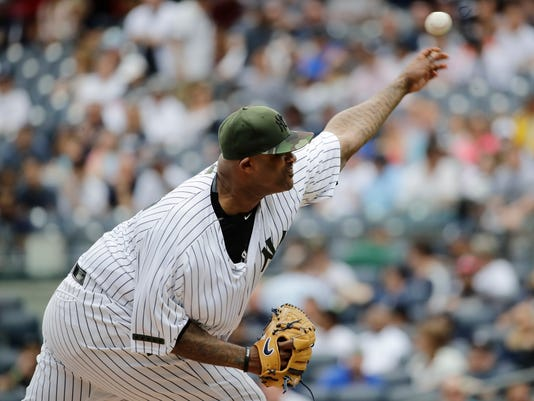 New York Yankees' CC Sabathia delivers a pitch during the first inning of a baseball game against the Oakland Athletics Saturday, May 27, 2017, in New York.  (AP Photo/Frank Franklin II)