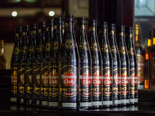 This June 8 file photo shows bottles of Cuban Havana Club rum displayed on the bar at the Rum Museum in Havana, Cuba. The Obama administration on Friday announced it is eliminating a $100 limit on the value of Cuban rum and cigars that American travelers previously faced.